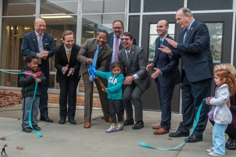 Cutting the ribbon to open the Cummings early childhood center.