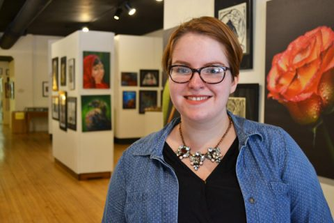 UM-Flint Art student Janice McCoy at the Greater Flint Arts Council student exhibition.