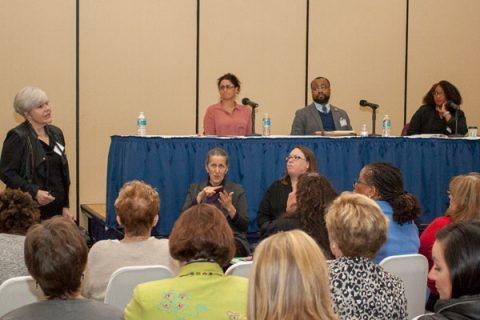 """Mary Jo Finney, PhD, moderates the panel """"A State of Crisis: Exploring solutions to counter systemic inequity,"""" with Dr. Mona Hanna-Attisha, Lenwood Hayman, PhD, and Dr. Iheoma Ikura."""