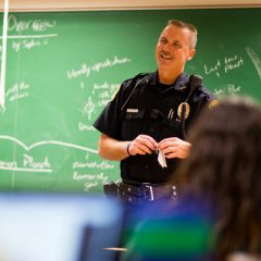 A UM-Flint public safety officer meeting with campus.