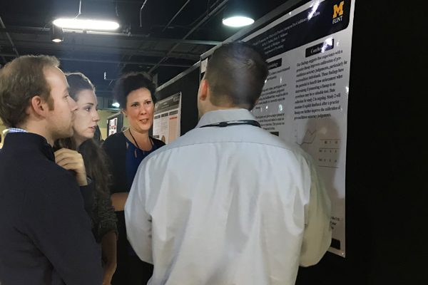 UM-Flint Psychology research assistants discuss their findings with AP-LS conference attendees