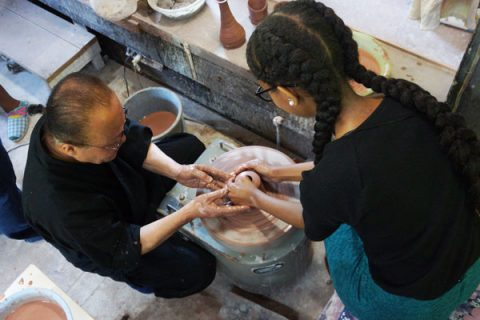 Nick Looney's photo of a UM-Flint student learning techniques from a ceramicist in Hida-Osaka.