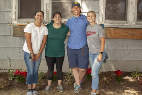 Left to right: Samantha Garcia, homeowner; Megan Heyza of the Eastside Improvement Association; Rebecca Tonietto, UM-Flint assistant professor of biology; Megan Cate, UM-Flint student