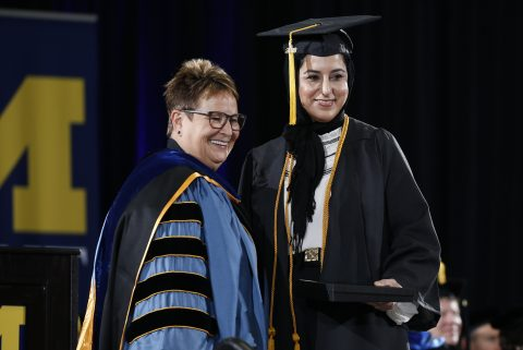 Chancellor Borrego congratulates Aisha Changezi on receiving her bachelor of fine arts degree.