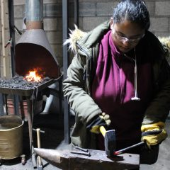 UM-Flint student Andleeb Baig makes a rivet the old fashion way at the Forge at Factory Two.