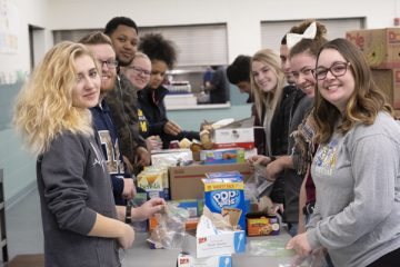 First-Year Experience students helping out at Flint's Center for Hope.
