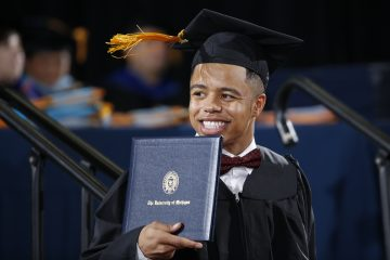 Flint native Rayshawn Riley received his bachelor of business administration degree Sunday.