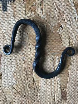 UM-Flint student Tabitha Robinson used her blacksmithing skills to make this hook.