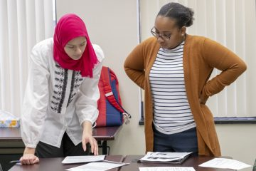 Students prepare for their service-learning class within the Teaching English to Speakers of Other Languages (TESOL) certificate program.