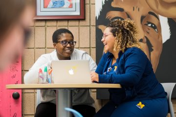 Peer educators Niyah Lewis and Marissa Charles working in the Center for Gender and Sexuality