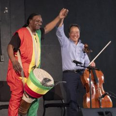 "Yo-Yo Ma (right) performs with Kevin ""Baba"" Collins of the Kuungana African Drum and Dance Company of Flint. Photo by Lindsay Stoddard"