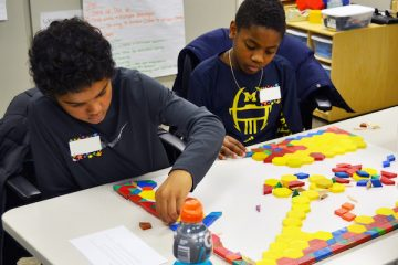 elementary students working on math games