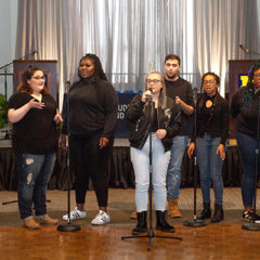 Students performing at the Celebrating Wolverine Excellence awards ceremony