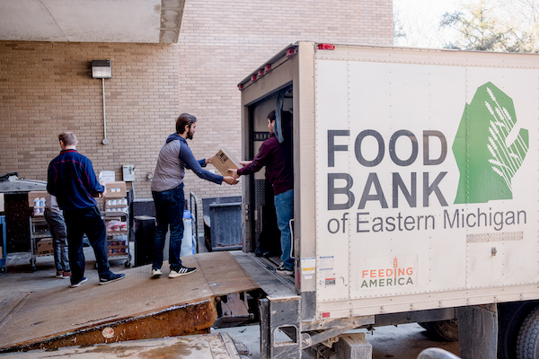 UM-Flint students unload food items from the Food Bank of Eastern Michigan