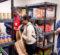 UM-Flint students organizing the student food pantry