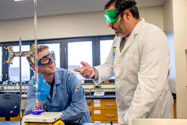 Green chemistry student Nicholas Wills works alongside associate professor Nick Kingsley, PhD.