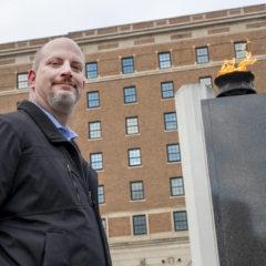 UM-Flint student and veteran Samuel Pickering stands for a portrait in Veterans Memorial Park in Flint.