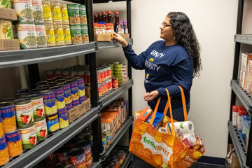Adelina Gutierrez, a UM-Flint senior, volunteers at the Wolverine Food Den, a food pantry for students experiencing food insecurity.