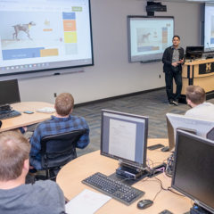 A class Assistant professor of Computer Science Zahid Syed and students in a cyber classroom. (Photo by Logan McGrady, College of Arts and Sciences)being held in a cyber classroom