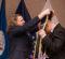 Helen Budd places stole on on graduate at Veterans' Graduation Dinner. (Photo by UM-Flint)