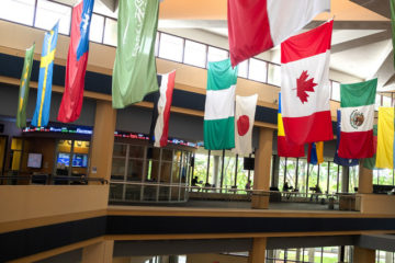 Flags from several nations hang in the University of Michigan-Flint's Riverfront Center. (