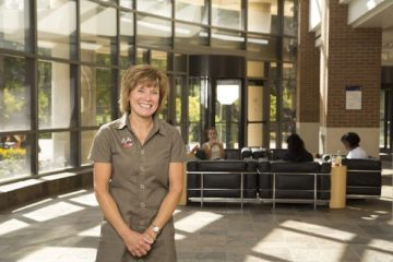 Maureen Tippen poses for a portrait in the lobby of the White Building at UM-Flint.