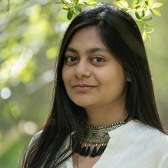 Headshot of Ayana Ghosh in nature