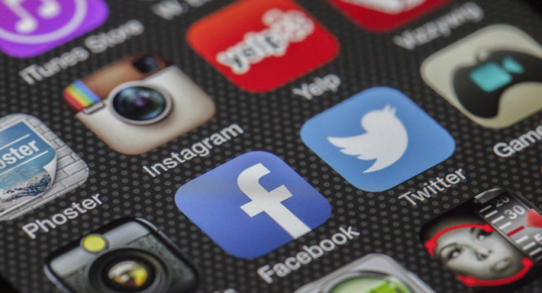 A smartphone screen showing app icons for social media sites.