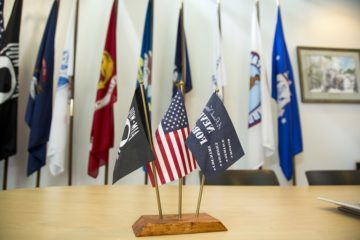 Photo of flags in the Student Veterans Center