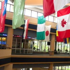 Flags of various nations hang in the Riverfront Residence Hall