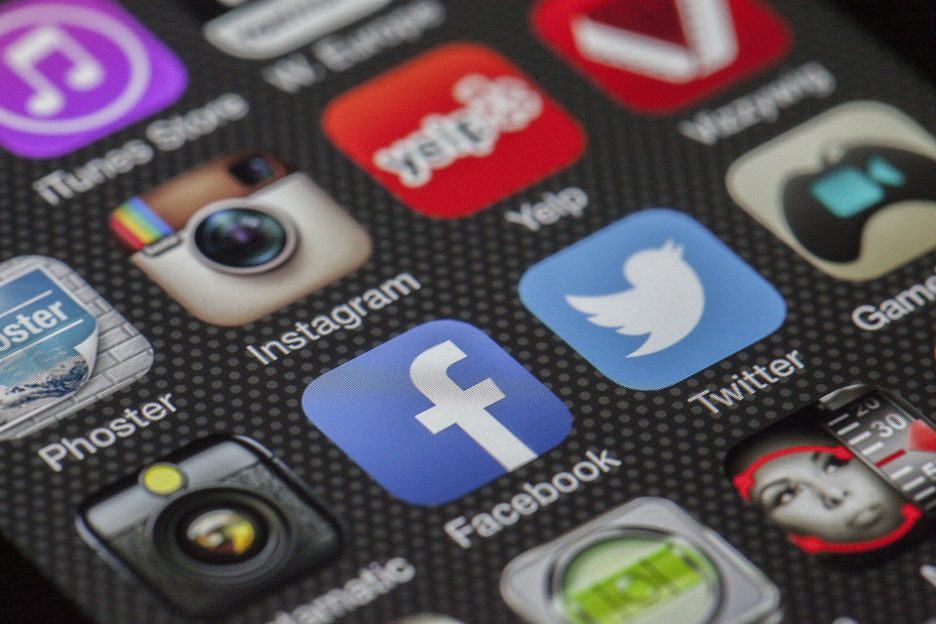 A phone screen showing Facebook, Instagram, and Twitter