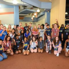 A group of 32 EOI students and staff pose for a photo as part of the EOI Summer Bridge Program.