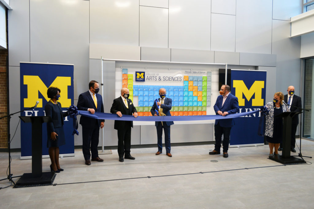 Pictured L to R: Provost Sonja Feist-Price, Regent Michael Behm, Mayor Sheldon Neeley, Chancellor Deba Dutta, Senator Jim Ananich, CAS Dean Susan Gano-Phillips, CIT Dean Christopher Pearson preparing to cut a ceremonial ribbon.