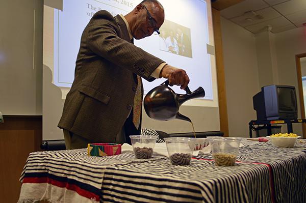 A photo of Guluma Gemeda pouring traditional coffee.