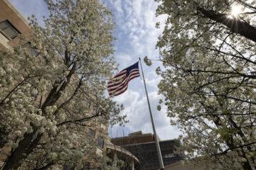 An American flag flies on UM-Flint's campus