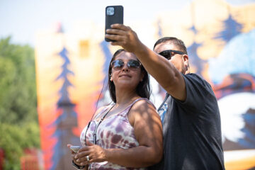 Photo of people taking selfie with cell phone