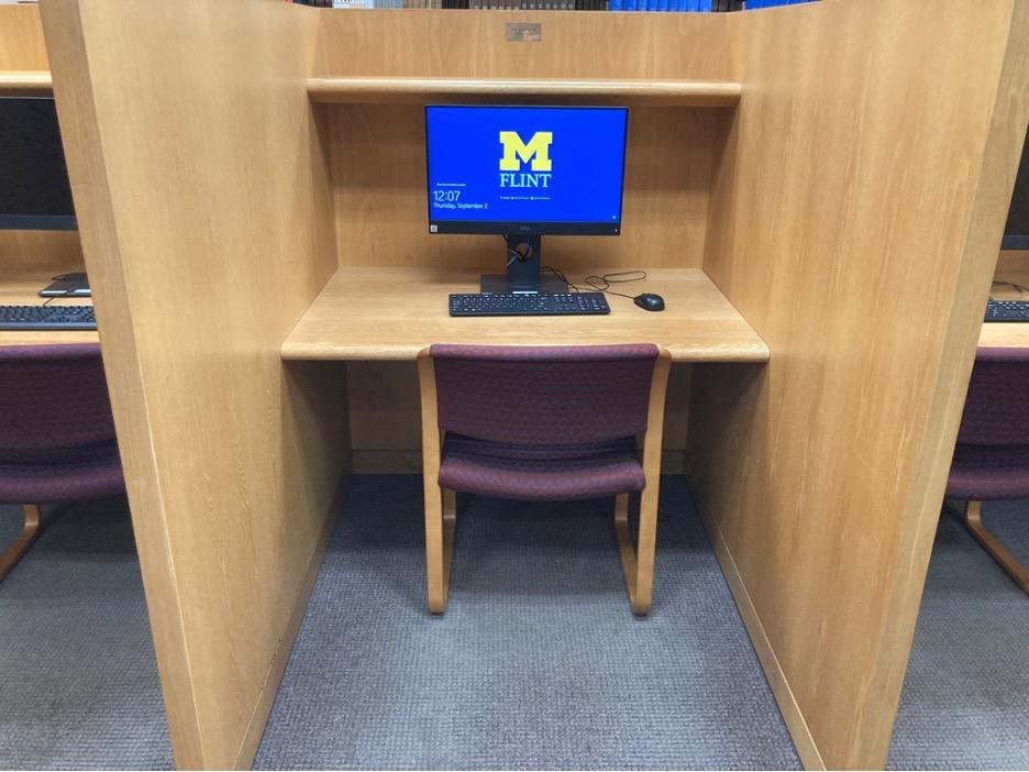 A computer in a study cubbie